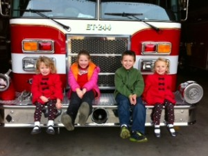 Georgie, Grace, Ryan and Maggie!  Luckily this was a fun visit to the fire station and no firemen were injured in the process.