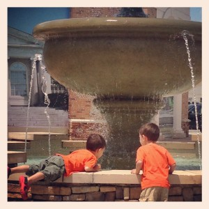 """You see Miles, this is how you climb into the fountain.  It's easy."""