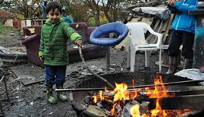 The author's son, playing with fire, in The Land.