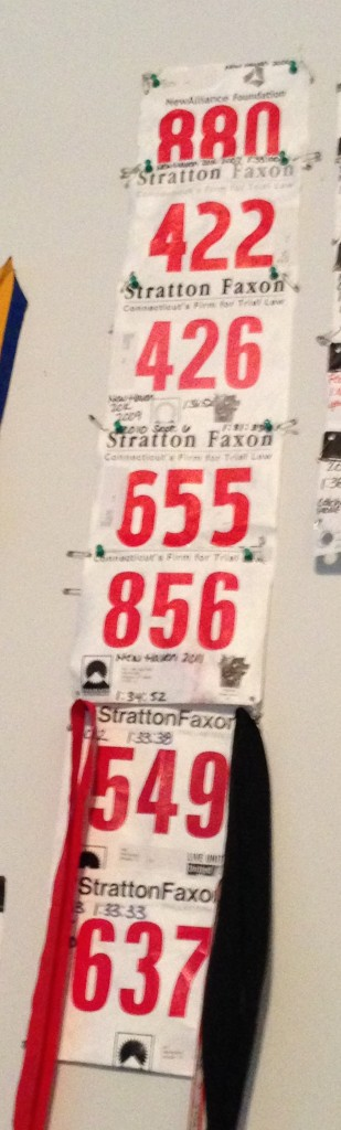"All my racing bibs from New Haven - going back to 2008 or ""BK"" before kids! What was that like? Oddly enough, 2008 was not my fastest finish."