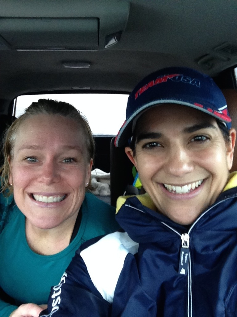 Shannon and I (like wet dogs!) changing in my car after the half so we could cheer Chrissie into the marathon finish!