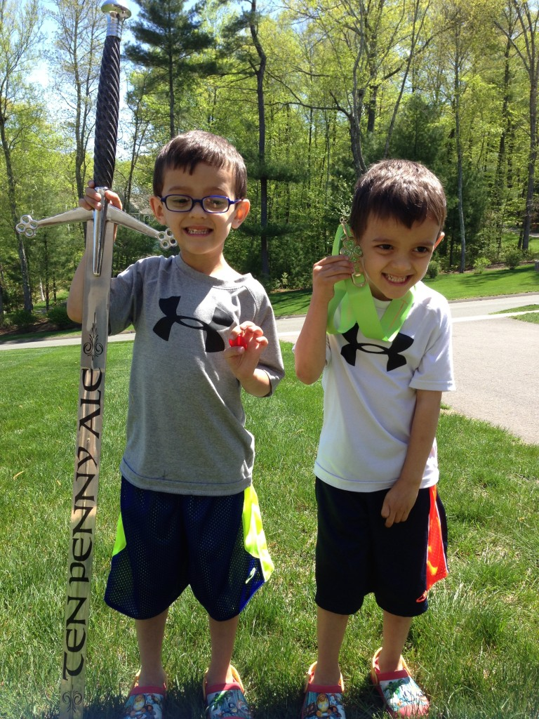 My boys, with the sword I won, in the Ten Penny Ale Duathlon in 2014.