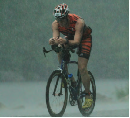 This is him biking though what looks like a monsoon at an IM in Lake Placid.