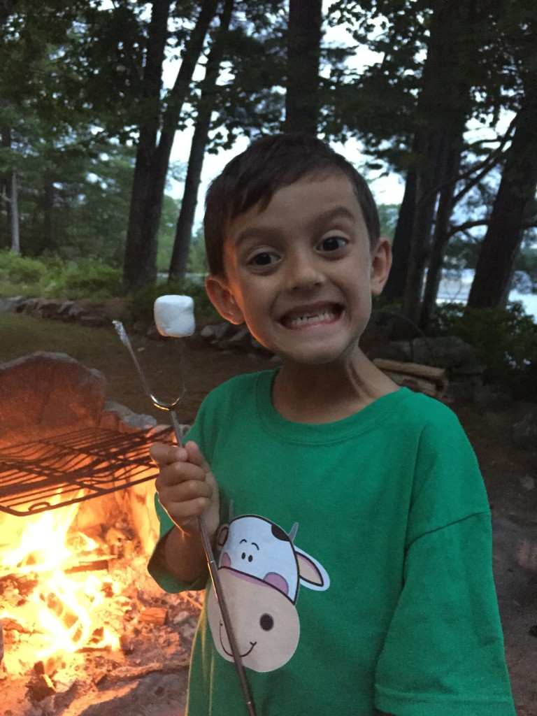 Someone is a little excited to be roasting marshmallows.
