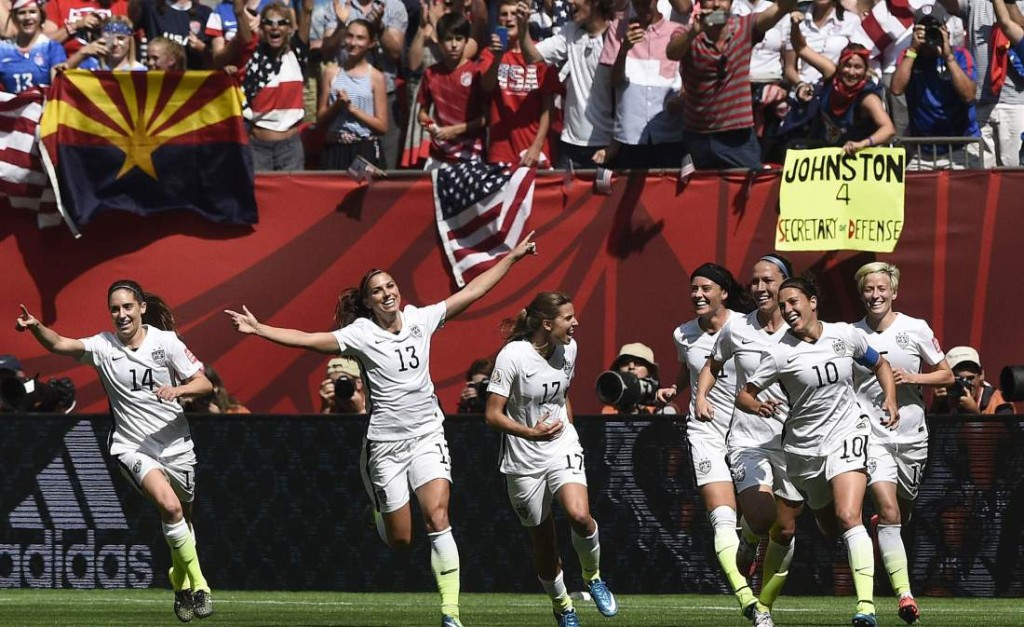 USA midfielder Carli Lloyd (10) celebrates her goal with teammates during the final football match between USA and Japan during their 2015 FIFA Women's World Cup at the BC Place Stadium in Vancouver on July 5, 2015.  AFP PHOTO / FRANCK FIFEFRANCK FIFE/AFP/Getty Images