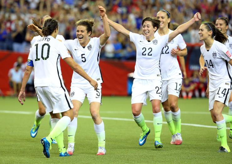 The United States team celebrates following Kelley O'Hara's goal against Germany. Source