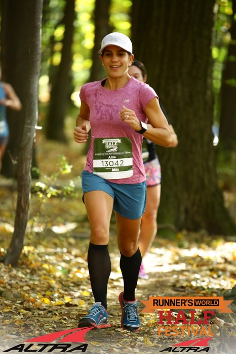 Just happily running through the woods during the Altra Trail Race on Day 1.