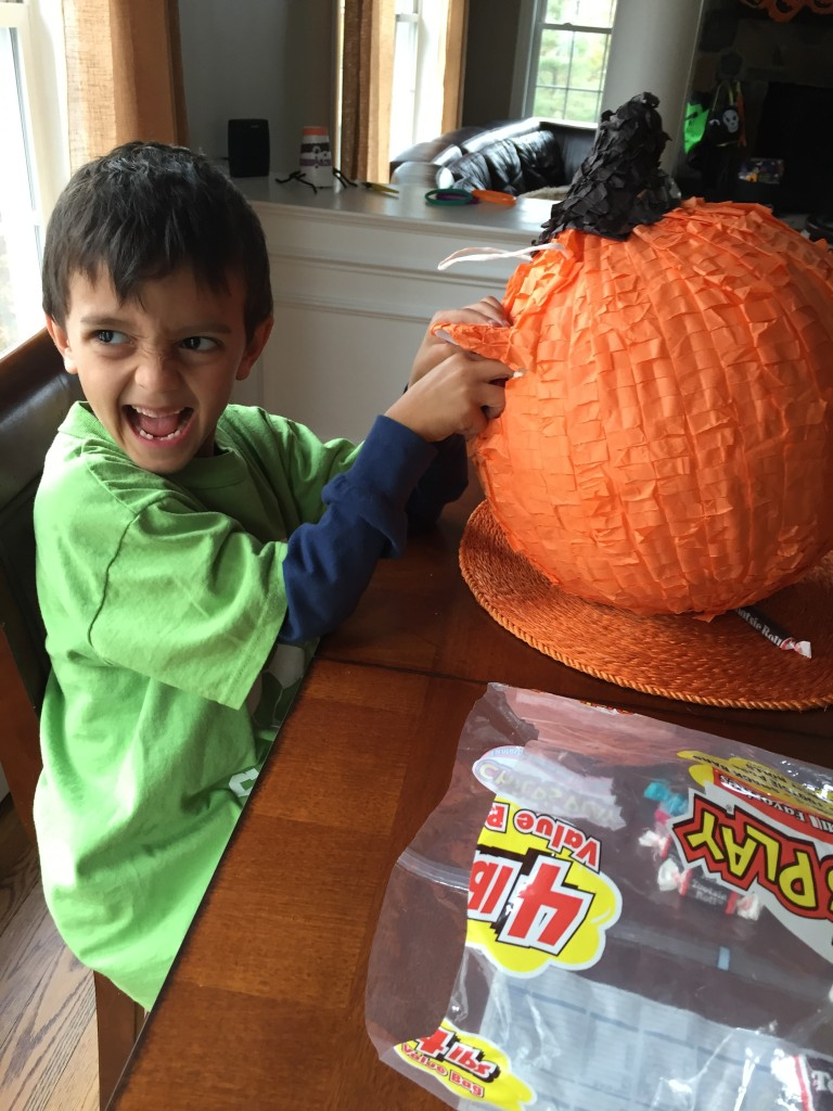 Evil Miles filling the piñata! Yes, we had a pumpkin piñata and didn't even bust it open since the kids had ingested enough candy by 5:30pm to last a lifetime.