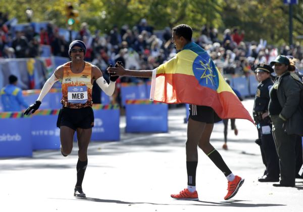 Fine. I would go out of my way to give Meb a high-five.