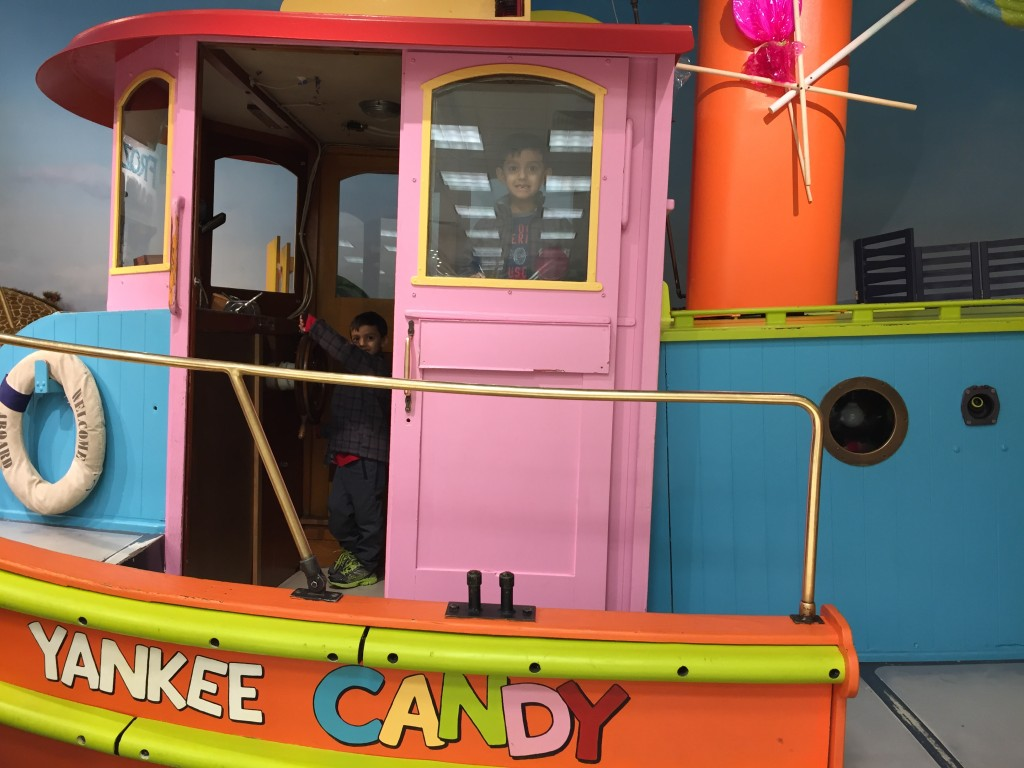 No candle store is complete without a giant pastel colored ship in the middle of a candy store, right? WTH?