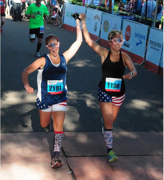 Alisha Perkins and friend Alyssa finish the Red, White and BOOM half-marathon in 2014.