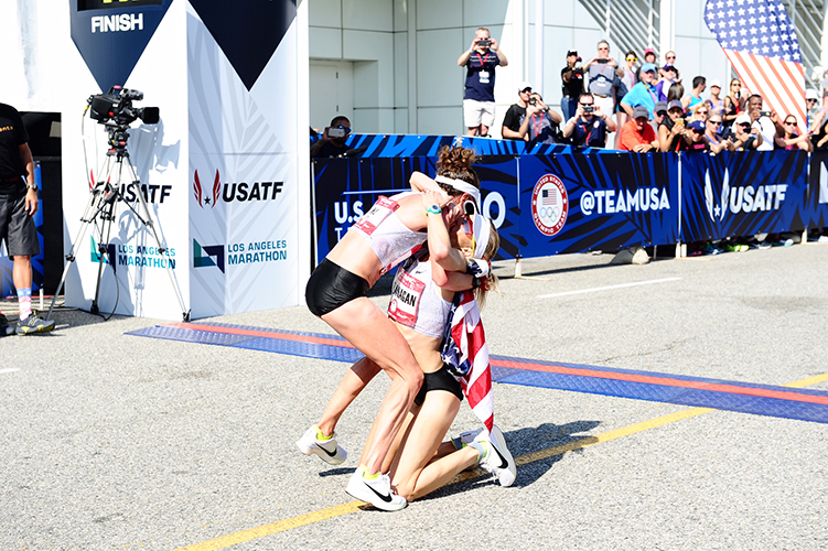 Shalane collapsing into her teammate (and fellow Olympic marathon qualifiers) arms right after crossing the finish.