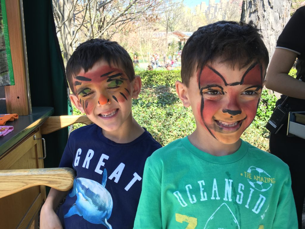 Face painting at the Central Park Zoo. The boys love being in their natural environment.