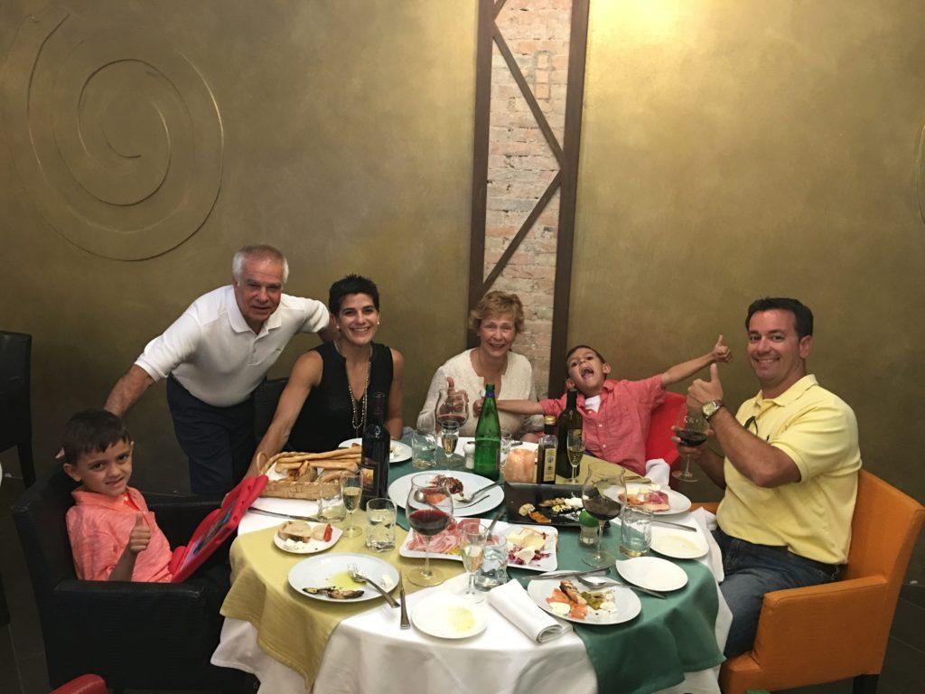 Enjoying dinner as a family in Sorrento.