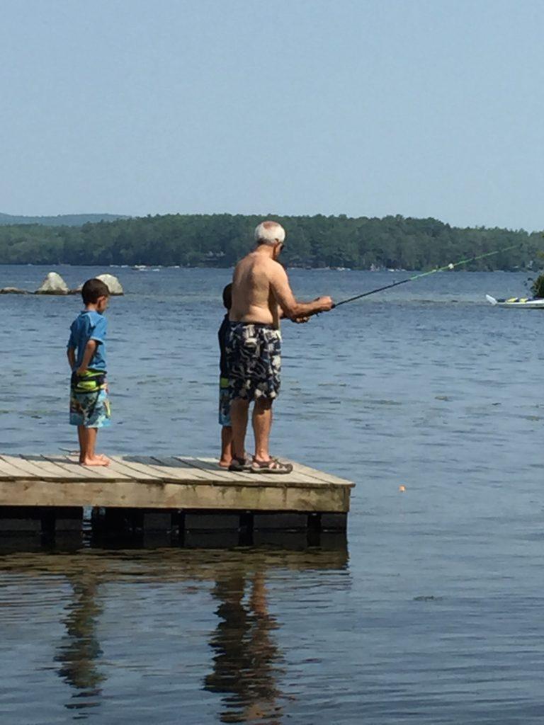 Teaching the boys to fish in Lake Winni last summer.