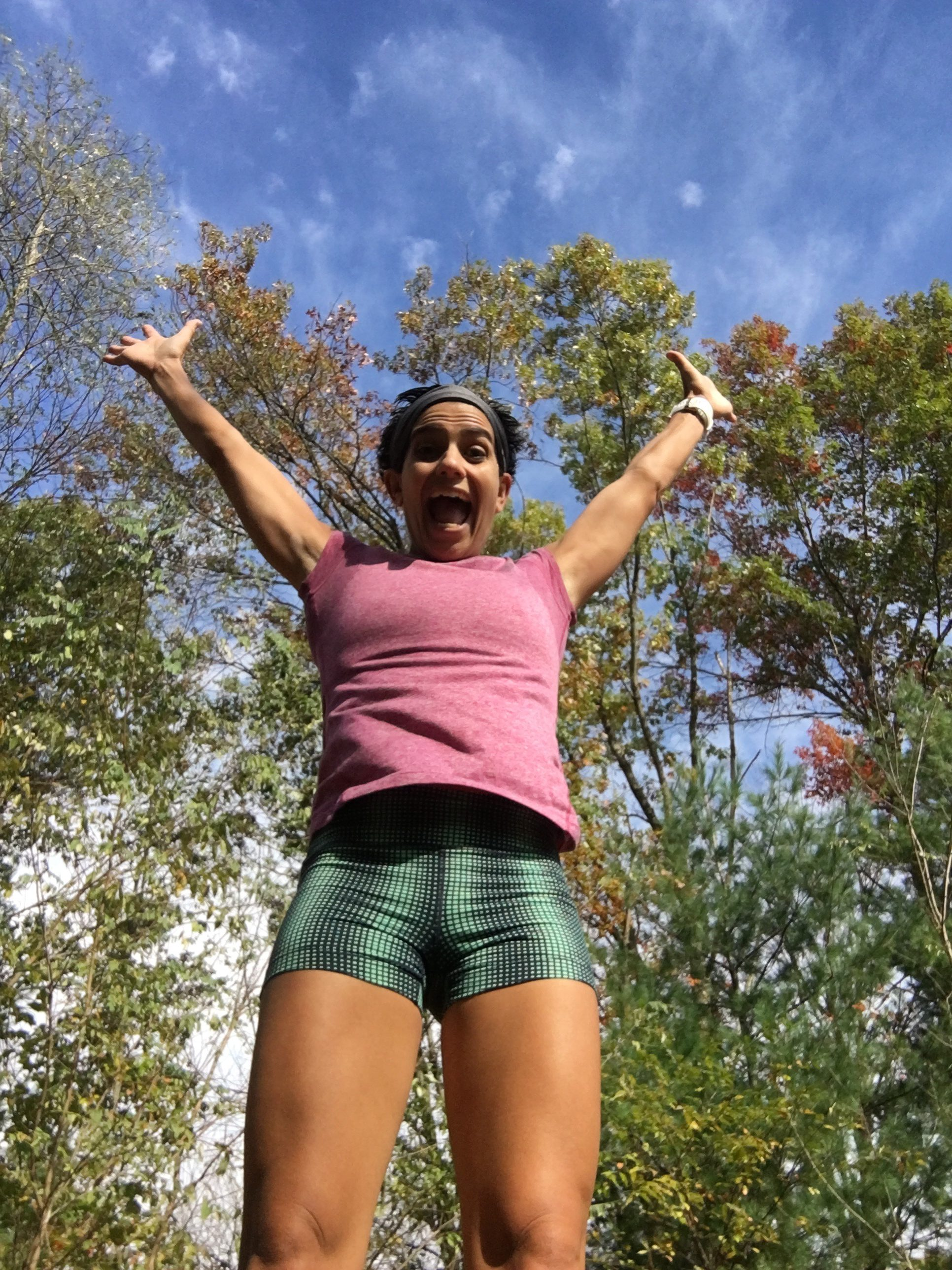Jumping for joy because the fox didn't get me on the run in the woods!