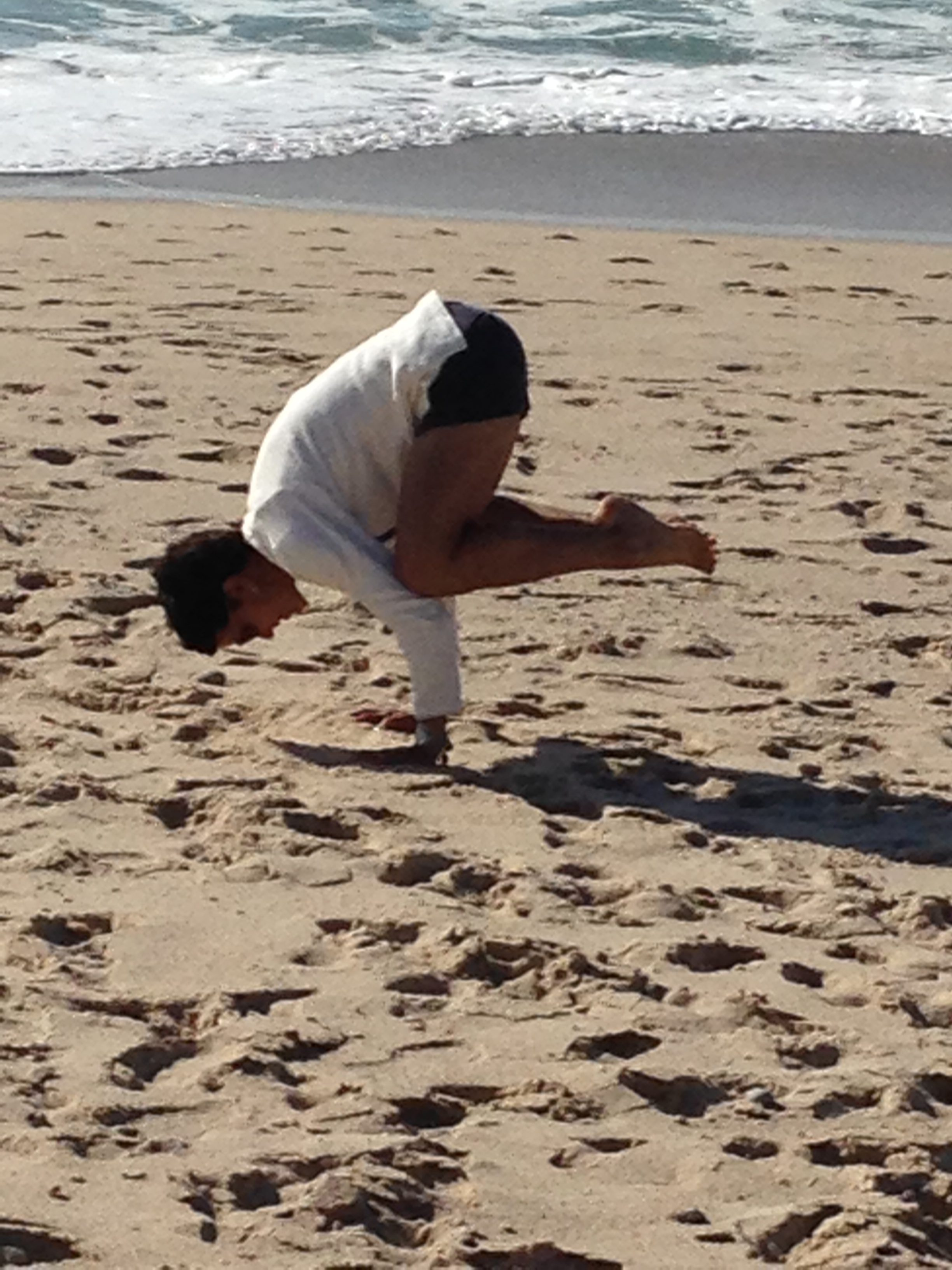 A rare photo of me doing yoga. This is crow pose on the beach in Portugal after my duathlon in Spain in 2014.